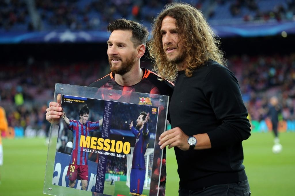 Lionel Messi and Carles Puyol