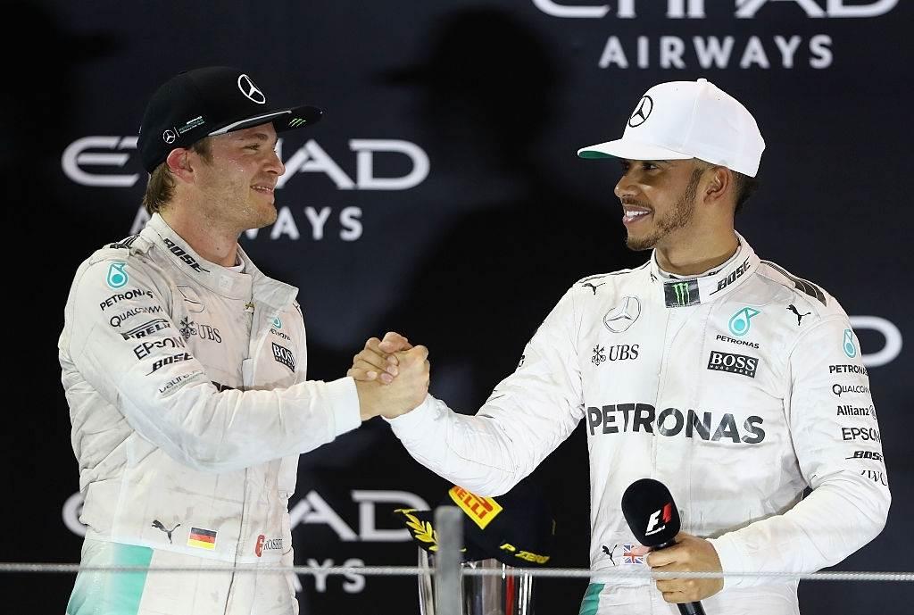 Nico Rosberg shaking hands with Lewis Hamilton