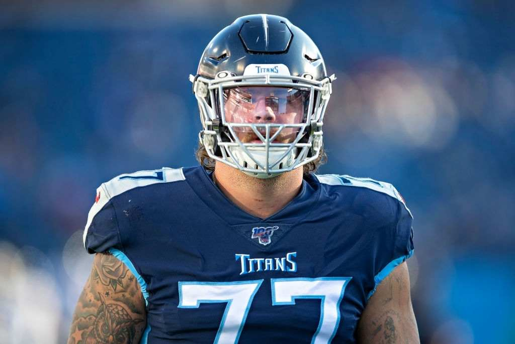 Taylor Lewan #77 of the Tennessee Titans warms up before a game against the Jacksonville Jaguars at Nissan Stadium on November 24, 2019 in Nashville, Tennessee. The Titans defeated the Jaguars 42-20.